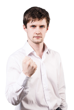 threaten: Young handsome businessman shows threaten fist isolated on white