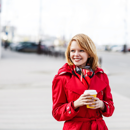 autumn young: Young beautiful woman with to go coffee on the street Stock Photo