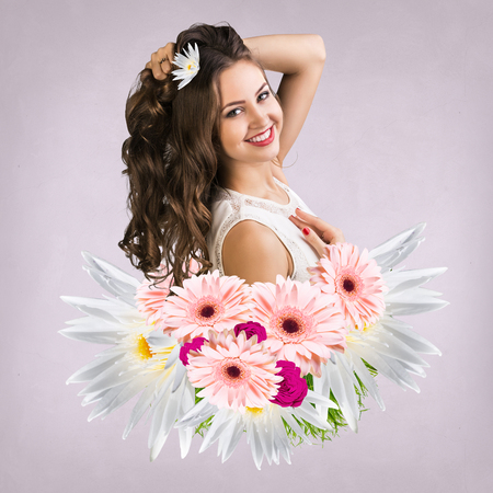 appears: Young attractive woman with clean skin appears from bouquet flowers over pink background