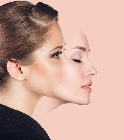 falsity: Young woman taking off a mask over pink background