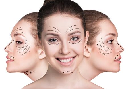Mooie gezichten van de jonge vrouw met het opheffen van pijlen geïsoleerd op wit. Plastische chirurgie begrip Stockfoto