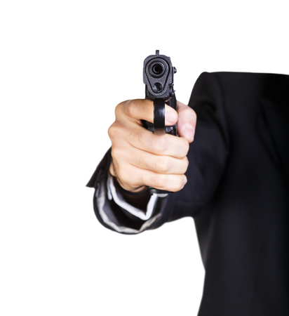 glock: Man pointing a gun at the camera on a white background. Focus on the front of the gun. Stock Photo