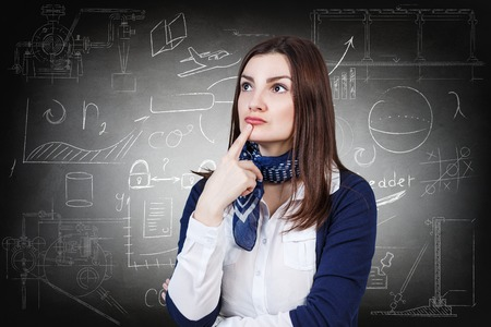 thoughtful: Thoughtful woman over school chalk board background Stock Photo