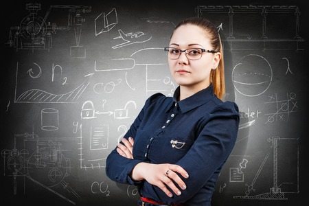 pensive: Young serious girl over school chalk board background