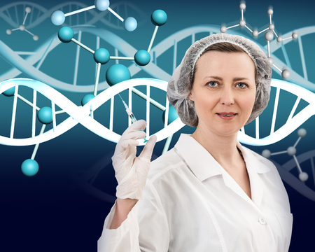 Smiling female doctor in white coat and dna molecule formula over gray background Stock Photo