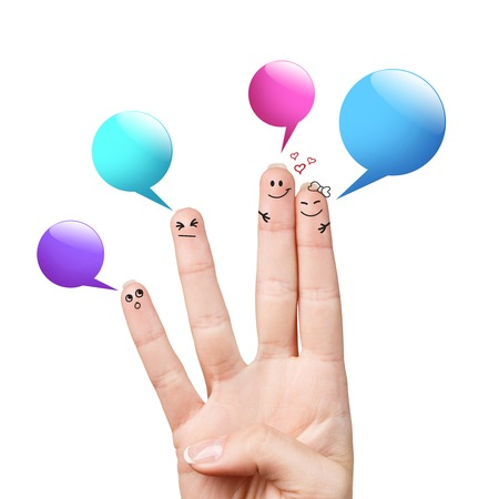 smileys: Happy finger smileys with colorful speech bubbles over white background Stock Photo