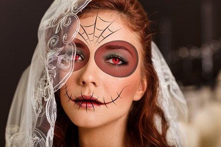 Beautiful bride in day of the dead mask skull face art Stock Photo