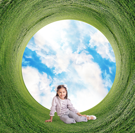 Stereographic panoramic projection of a green field and sky