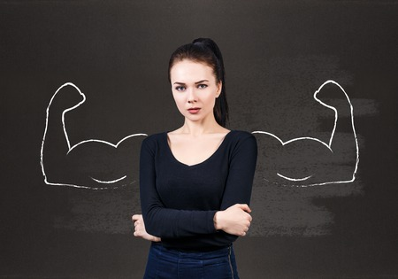 overbearing: Young business woman with drawn powerful hands behind