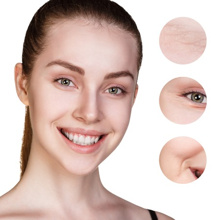 Beautiful young woman face with zoom circles shows wrinkles Stock Photo
