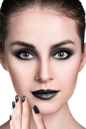 smoky eyes: Young beautiful woman with smoky eyes makeup over white background Stock Photo