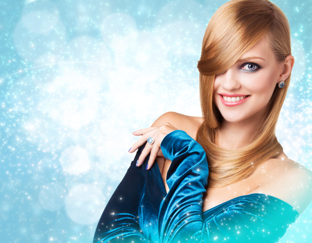 Portrait of beautiful styling woman over winter Christmas background. Stock Photo
