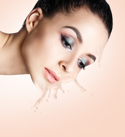 Cosmetics flows down from beautiful face. Stock Photo