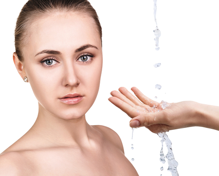 Woman face and pouring water in hand.