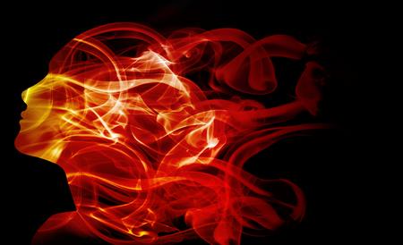 女性の頭と炎のような煙の二重露光。 写真素材