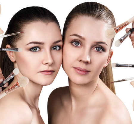 Two young women and makeup brushes. Stock Photo