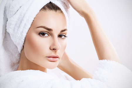 Young sensual woman with bath towel on head. Banque d'images