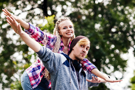 Young couple fool around in the summer park. Stock Photo