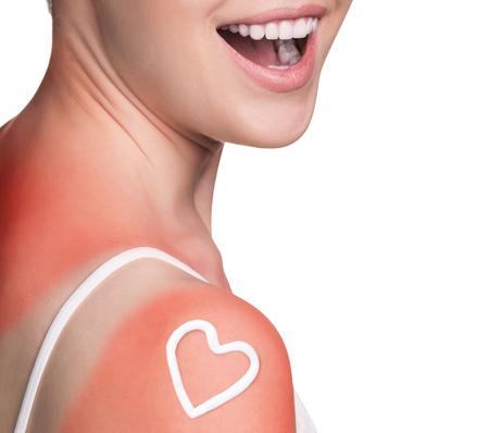 Sunblock on the female shoulder. Stock Photo
