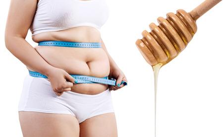 Fat woman preparing for honey massage.