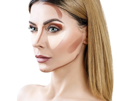 Adult woman with contouring makeup on face.