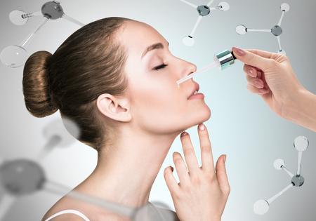 Cosmetics oil on face among the molecules Foto de archivo