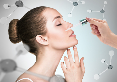 Cosmetics oil on face among the molecules Banque d'images