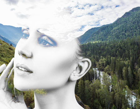 Double exposure of woman and nature landscape