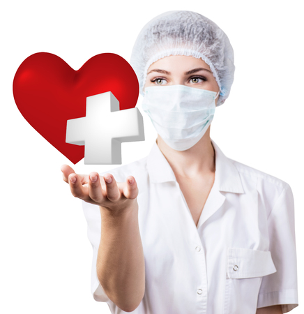Cardiologist woman doctor holding big red heart. Stock Photo
