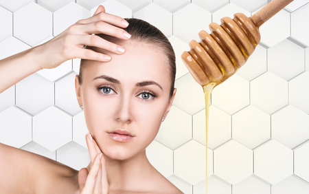 Young woman prepare for honey facial mask.