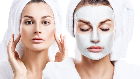 Beautiful woman with mask on face and massaging.