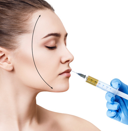 aging face: Beautiful woman gets injection in her lips.