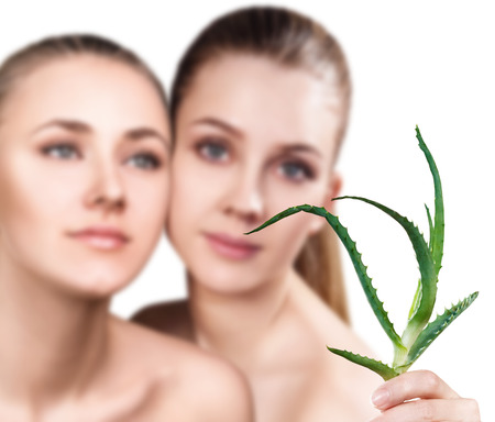 aging face: Women with aloe vera plant and perfect skin. Stock Photo