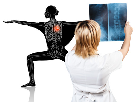 Female doctor looks on x-ray of sporty woman.
