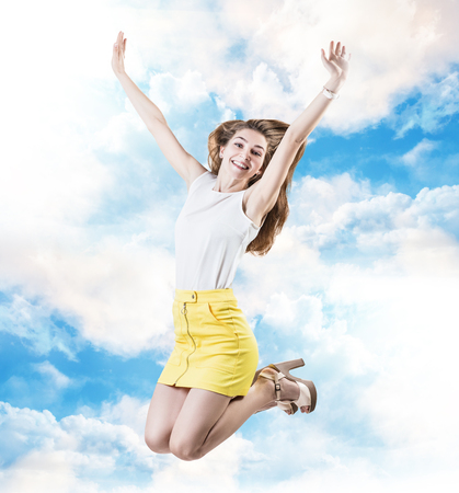 Young business woman feels freedom in the sky.