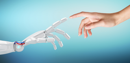 Human hand touching an android hand. Banque d'images