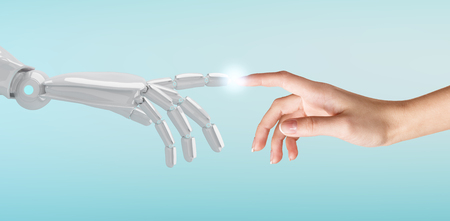 Human hand touching an android hand. Stock Photo