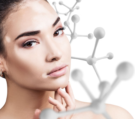 Young sensual woman with big white molecule chain. Stock Photo