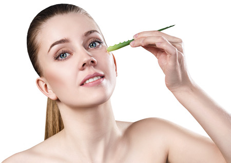 Young woman uses aloe vera oil for skin. Stock Photo