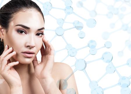 Young woman with vitiligo among blue glass molecules. Stock Photo