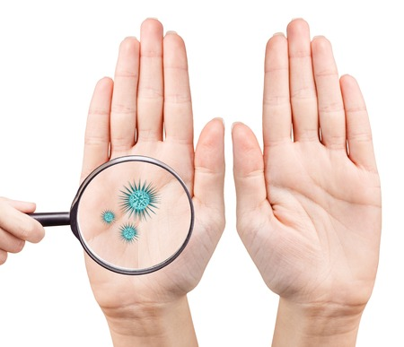 Microbes on humans hand shows by mygnifying glass. Hygiene concept. 3D rendering Stock Photo