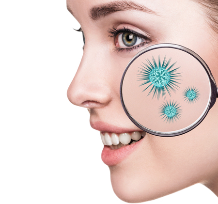 Magnifying glass with microbes on female face.