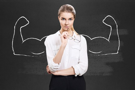 Business woman with drawn powerful hands. Stock Photo