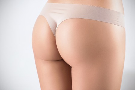 Beautiful perfect buttocks of young woman.