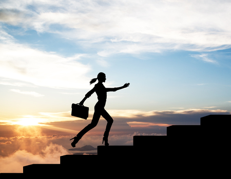 Silhouette of woman rise up on stairs from business word.