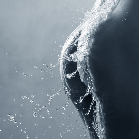 Sexy woman back in splashes of water.