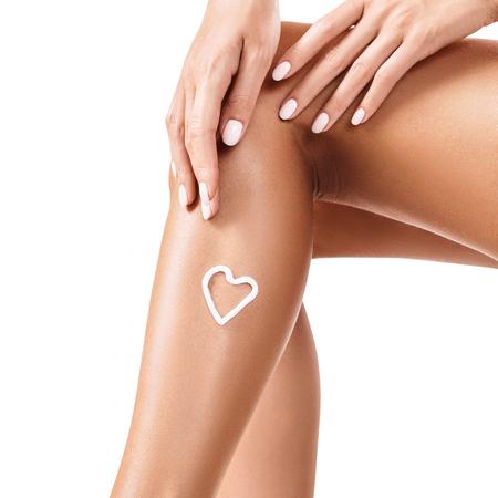 Woman has cream on her leg.