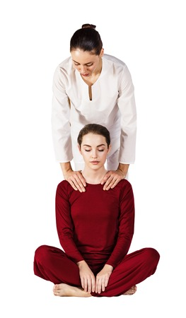 Young woman getting traditional thai stretching massage.