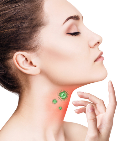 Young woman shows sore throat with green microbes Stock Photo