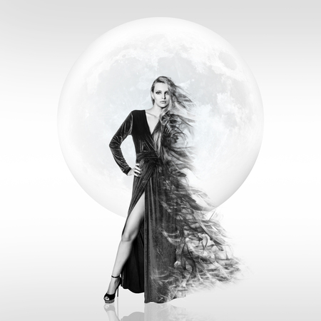 Stylish young woman over full moon background. Stock fotó